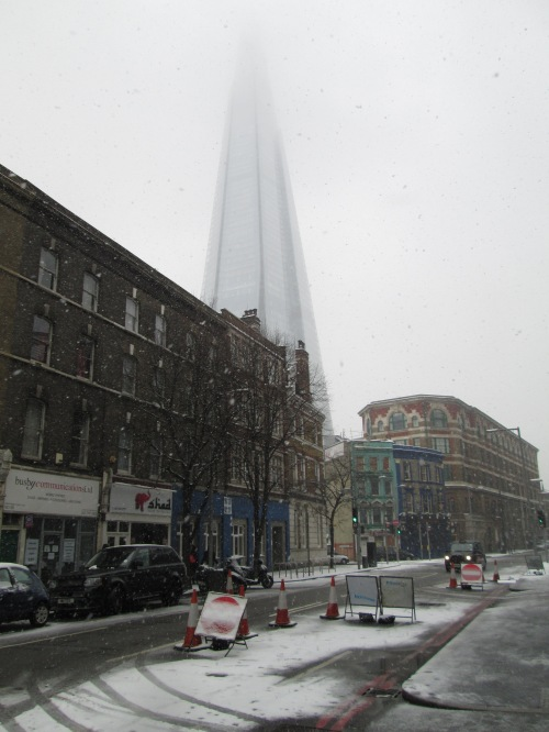 A street south of the river, with the ghostly Shard Building above